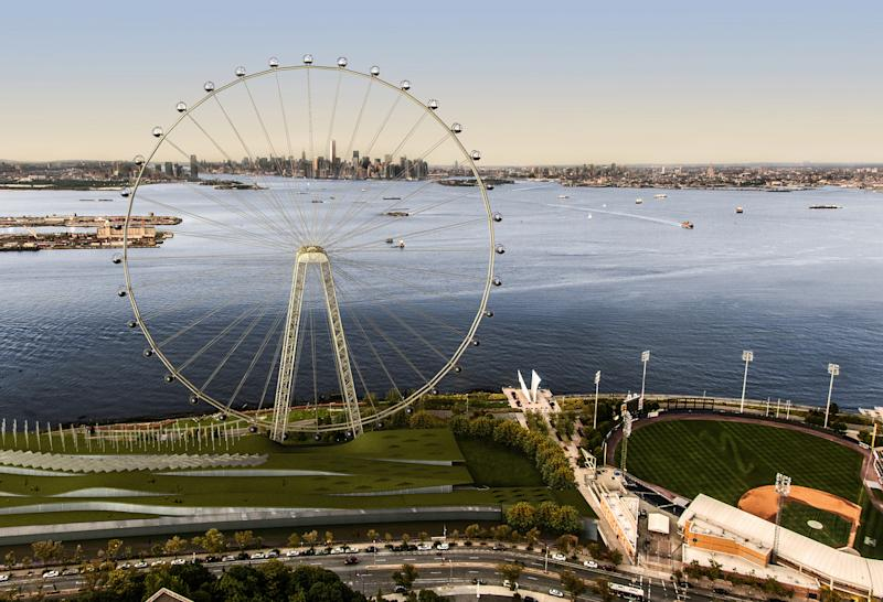 "In this image released by the New York Mayor's Office, Thursday, Sept. 27, 2012 is an artist's rendering of a proposed 625-foot Ferris wheel, billed as the world's largest, planned as part of a retail and hotel complex along the Staten Island waterfront in New York. The attraction, called the New York Wheel, will cost $230 million. Officials say the observation wheel will be higher than the Singapore Flyer, the London Eye, and a ""High Roller"" wheel planned in Las Vegas. Beyond the wheel is the Manhattan skyline. On the lower right is the Richmond County Bank Ballpark, home of the Staten Island Yankees. (AP Photo/Office of the Mayor of New York)"