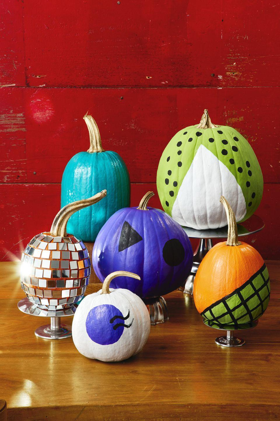 <p>Travel back in time to the good ol' days with this assortment of colorful painted pumpkins, ranging from ones that mimic disco balls (look at that sparkle!) to designs inspired by old-school record players. </p>