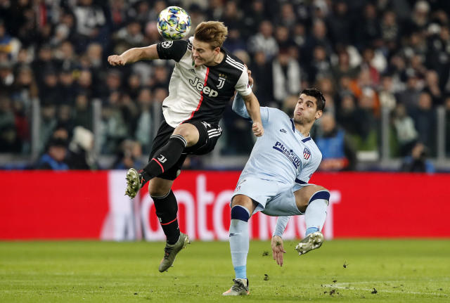 Juventus' Matthijs de Ligt, left, and Atletico Madrid's Alvaro Morata challenge for the ball during the Champions League group D soccer match between Juventus and Atletico Madrid at the Allianz stadium in Turin, Italy, Tuesday, Nov. 26, 2019. (AP Photo/Antonio Calanni)