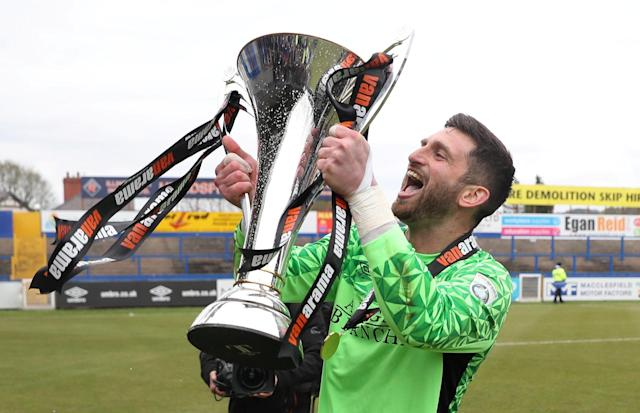 Soccer Football - National League - Macclesfield Town v Dagenham & Redbridge - Moss Rose, Macclesfield, Britain - April 28, 2018 Macclesfield Town's Shawn Jalal celebrates winning the league with the trophy Action Images/Peter Cziborra