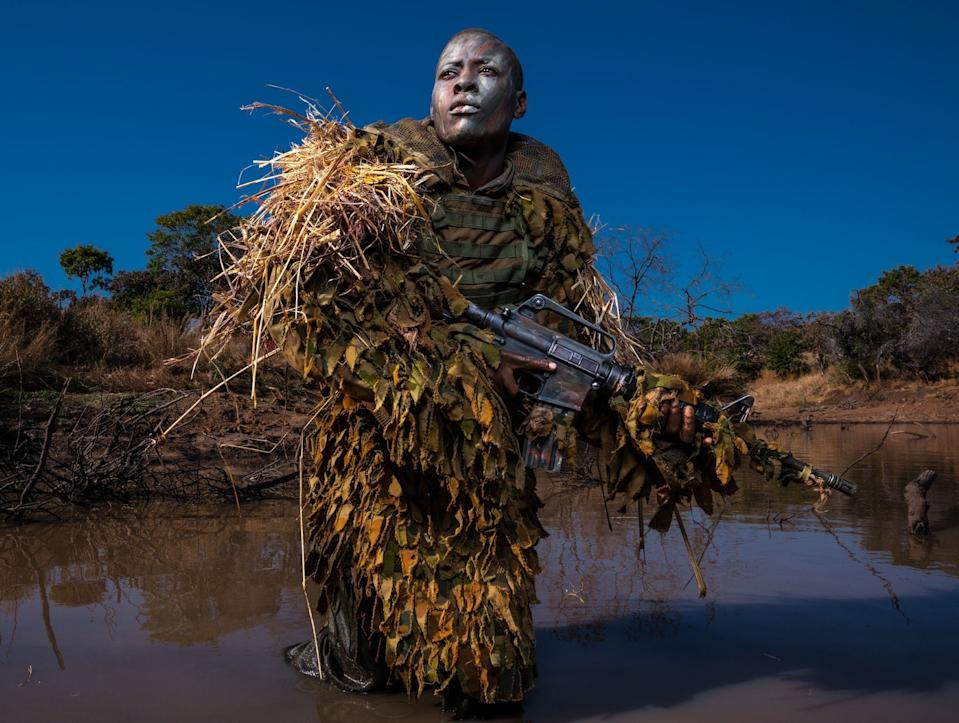 Petronella Chigumbura, a member of the Akashinga – a nonprofit, all-female anti-poaching unit – practices reconnaissance techniques in the Zimbabwean bush. (Picture: National Geographic/Brent Stirton)