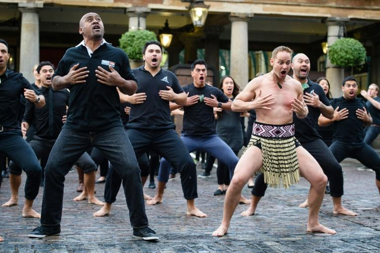 Late New Zealand rugby union player Jonah Lomu (L) and members of the Ngāti Rānana London Māori Club performing the haka in London's Covent Garden ahead of the Rugby World Cup, on September 16, 2015