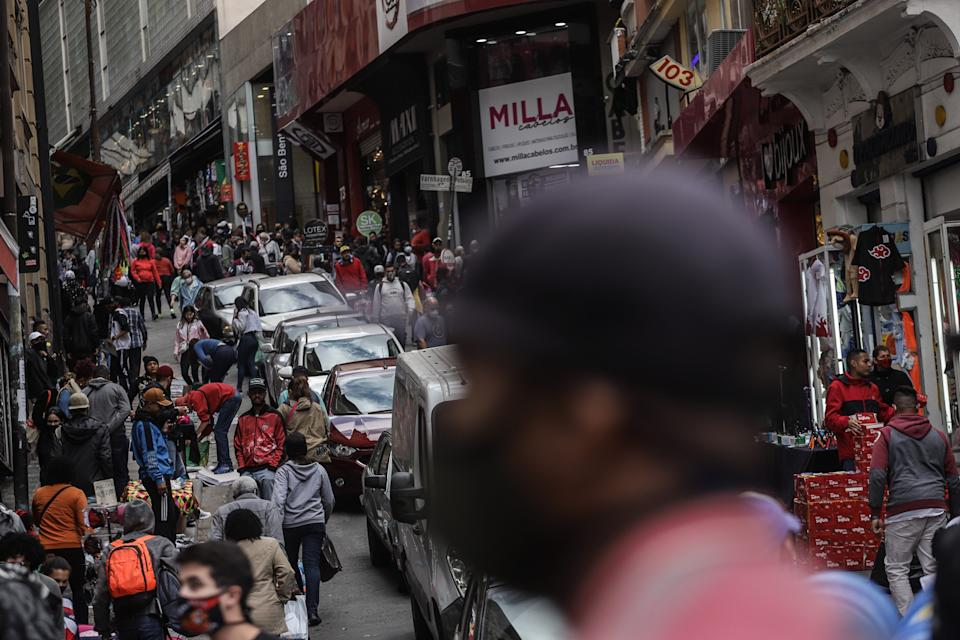 People walk in the street amid COVID-19 outbreak in Sao Paulo, Brazil, Aug. 4, 2021. According to official figures, Brazil has had over 20 million COVID-19 cases and more than 559,000 deaths. (Photo by Rahel Patrasso/Xinhua via Getty Images)