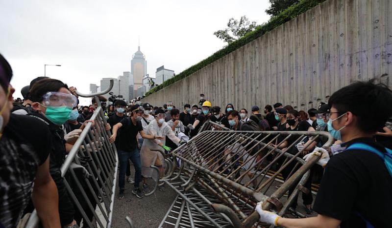 Hong Kong extradition bill: thousands of protesters block city streets and prepare for worst as riot police gather nearby