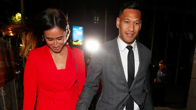 Maria and Israel Folau holding hands.
