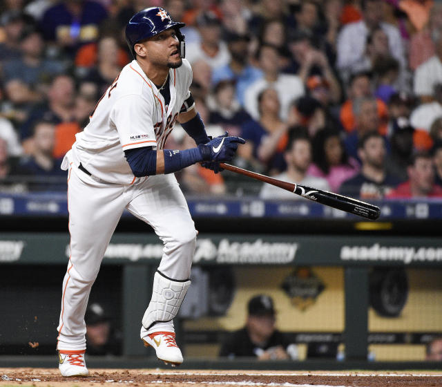 Houston Astros' Yuli Gurriel watches his solo home run off Chicago White Sox starting pitcher Dylan Covey during the fifth inning of a baseball game, Tuesday, May 21, 2019, in Houston. (AP Photo/Eric Christian Smith)