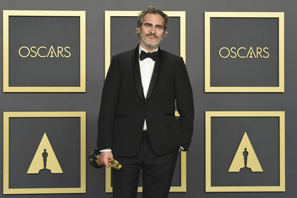 """Joaquin Phoenix, winner of the award for best performance by an actor in a leading role for """"Joker"""", on Sunday, Feb. 9, 2020. (Photo by Jordan Strauss/Invision/AP)"""