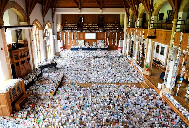 Thousands of birthday cards sent to Colonel Tom Moore for his 100th birthday on 30 April, displayed in the Hall of Bedford School. (Getty)