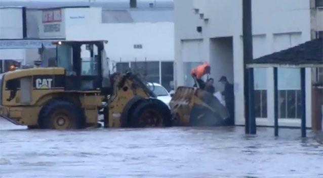 Locals pitching in on the ground. Source: 7News