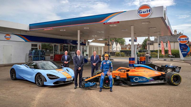 Lando Norris and Gulf Oil livery cars with McLaren executives