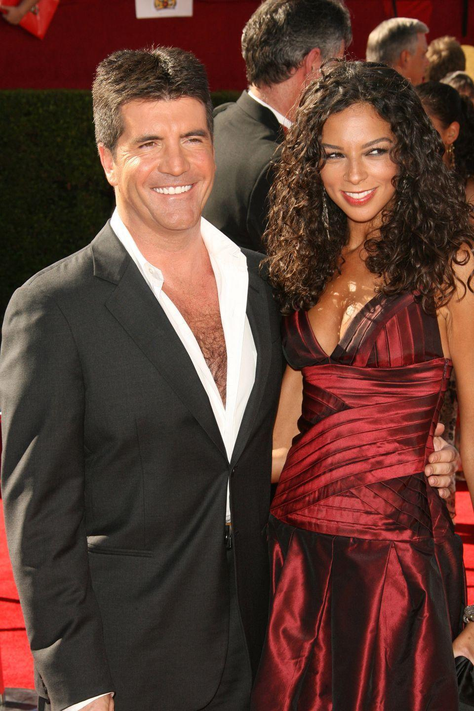 <p>Simon Cowell traded in his iconic <em>American Idol </em>deep V-neck tee for a deep V-neck button-down at the Emmys in 2006. Clearly, he has a go-to look.</p>