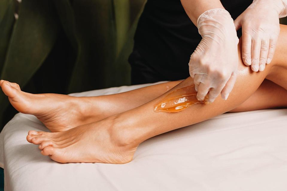 <h2>What Is Sugaring?</h2> <p>Sugaring is an all-natural alternative to waxing that requires the use of a sugar paste made with lemon, water, and sugar. It usually involves an aesthetician rolling a lump of the sugaring paste onto the skin and removing the hair follicles from the root using a flicking motion. </p> <h2>What Is Waxing?</h2> <p>Waxing also involves removing the hair from the root, but it's known for being a little faster than sugaring because you can apply it in strips on multiple parts of the area being waxed at once. This can typically be done using a hard wax or a soft wax; a hard wax hardens after being applied to the skin and can be removed using just your fingers once it sets, while a soft wax is thinner and requires the use of large paper strips to be removed.</p>