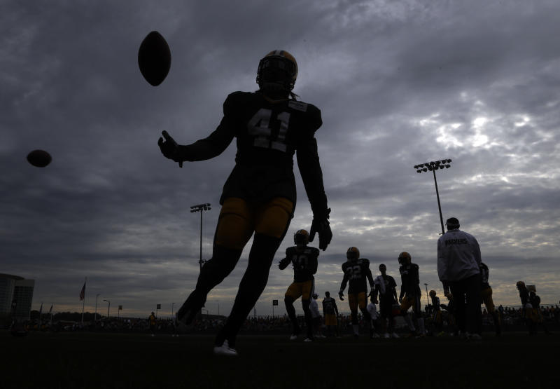 Green Bay Packers players run a drill during NFL football training camp Tuesday, July 30, 2013, in Green Bay, Wis. (AP Photo/Morry Gash)