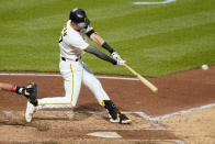 Pittsburgh Pirates' Kevin Newman doubles off Philadelphia Phillies starting pitcher Chase Anderson, driving in two runs, during the fifth inning of a baseball game in Pittsburgh, Friday, July 30, 2021. (AP Photo/Gene J. Puskar)