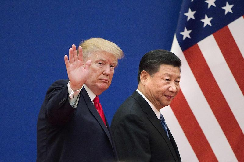 "(FILES) This file picture taken on November 9, 2017 shows US President Donald Trump (L) and China's President Xi Jinping leaving a business leaders event at the Great Hall of the People in Beijing. - US President Donald Trump on March 1, 2019, urged China to abolish tariffs on agricultural products imported from the United States -- adding that trade talks between the rival powers were going well. ""I have asked China to immediately remove all Tariffs on our agricultural products (including beef, pork, etc.),"" the president wrote on Twitter. (Photo by Nicolas ASFOURI / AFP)NICOLAS ASFOURI/AFP/Getty Images ORIG FILE ID: AFP_1E382Y"