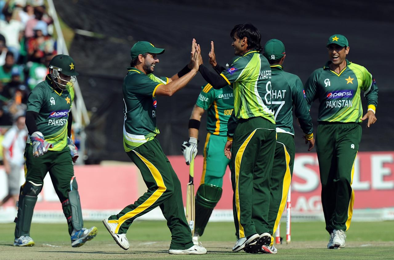 Pakistan's cricketer Mohammad Hafeez celebrates the wicket of South Africa's cricketer Colin Ingram during the 5th and final One-Day Internationals (ODI) cricket match between South Africa and Pakistan at Willowmoore Park in Benoni on  March 24, 2013.           AFP PHOTO / ALEXANDER JOE        (Photo credit should read ALEXANDER JOE/AFP/Getty Images)