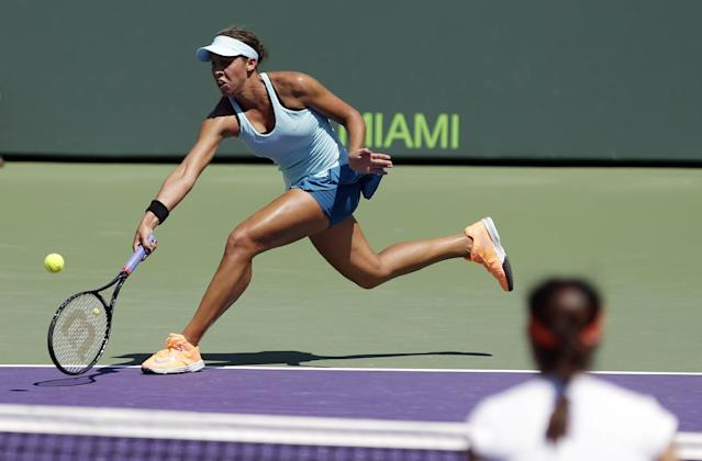 Madison Keys returns to Li Na, of China, at the Sony Open tennis tournament in Key Biscayne, Fla., Sunday, March 23, 2014. (AP Photo/Alan Diaz)