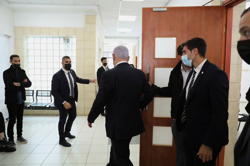 Israeli Prime Minister Benjamin Netanyahu, leaves the courtroom as his corruption trial resumes, at Jerusalem's District Court