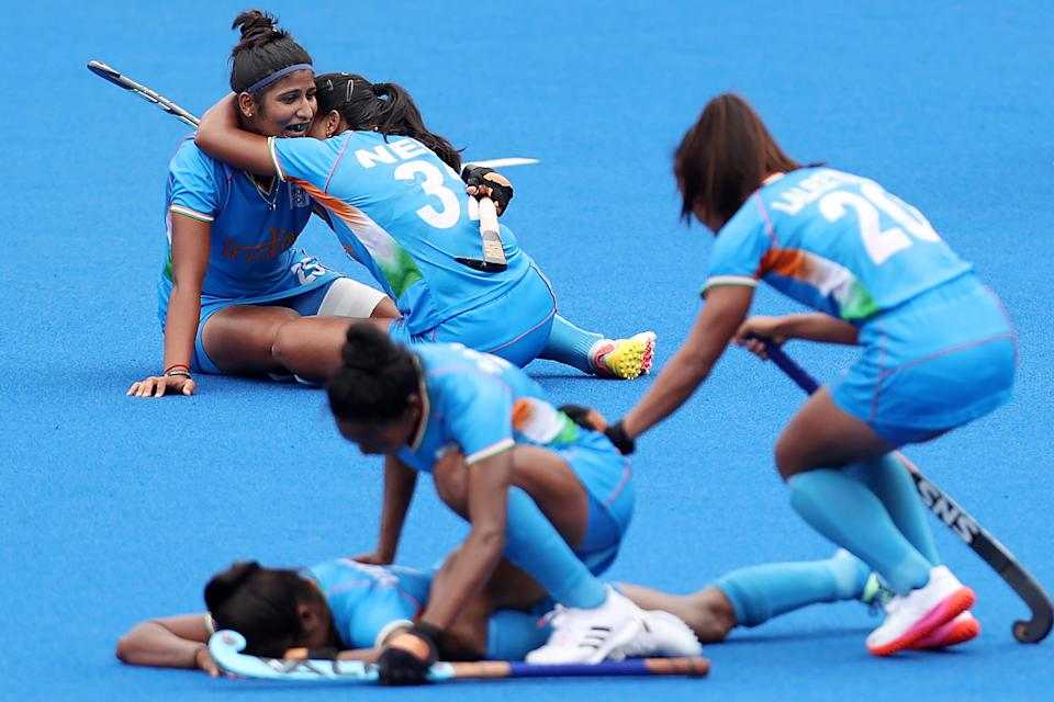 <p>Navneet Kaur, Neha Neha and Lalremsiami of Team India celebrate their 1-0 win with teammates while Karri Somerville reacts after the Women's Quarterfinal match between Australia and India on day ten of the Tokyo 2020 Olympic Games at Oi Hockey Stadium on August 02, 2021 in Tokyo, Japan. (Photo by Buda Mendes/Getty Images)</p>