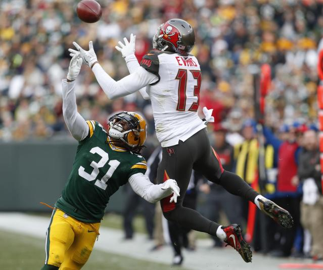 <p>Tampa Bay Buccaneers' Mike Evans catches a pass over Green Bay Packers' Davon House during the first half of an NFL football game Sunday, Dec. 3, 2017, in Green Bay, Wis. (AP Photo/Matt Ludtke) </p>