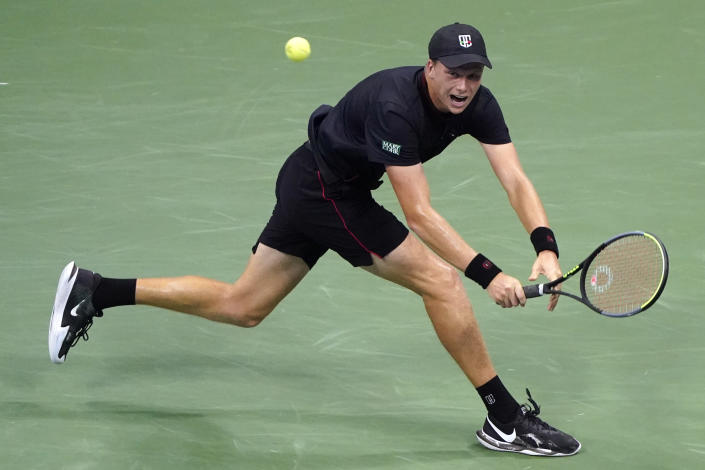 Jenson Brooksby, of the United States, returns against Novak Djokovic, of Serbia, during the fourth round of the U.S. Open tennis championships, Monday, Sept. 6, 2021, in New York. (AP Photo/John Minchillo)