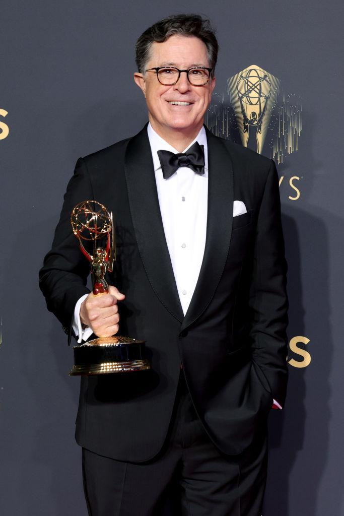 LOS ANGELES, CALIFORNIA - SEPTEMBER 19: Stephen Colbert, winner of the Outstanding Variety Special (Live) award for 'Stephen Colbert's Election Night 2020: Democracy's Last Stand Building Back America Great Again Better 2020,' poses in the press room during the 73rd Primetime Emmy Awards at L.A. LIVE on September 19, 2021 in Los Angeles, California. (Photo by Rich Fury/Getty Images)