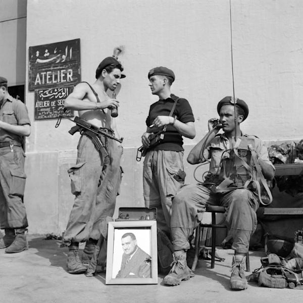 A file photo from November 1, 1956 shows Egyptian soldiers with a portrait of then president Gamal Abdel Nasser in Port Said at the height of the Suez canal crisis, after Nasser nationalised the key waterway