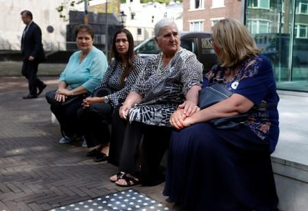 "Members of ""Mothers of Srebrenica"" association wait during the ruling on the case brought by relatives of the victims of the 1995 Srebrenica massacre, at the Dutch high court in The Hague"