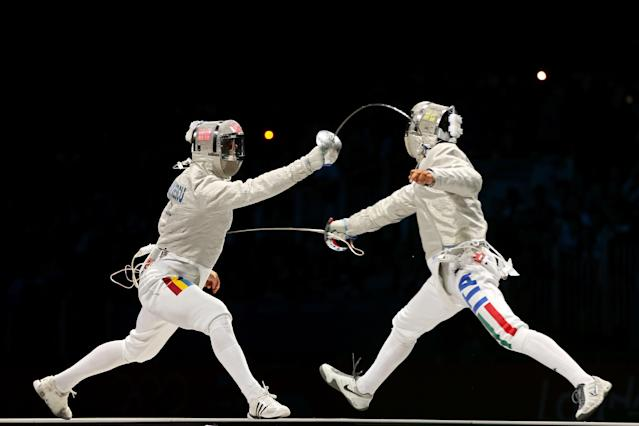 LONDON, ENGLAND - JULY 29: Diego Occhiuzzi of Italy competes against Rares Dumitrescu of Romania during their Men's Sabre Individual semifinal match on Day 2 of the London 2012 Olympic Games at ExCeL on July 29, 2012 in London, England. (Photo by Hannah Johnston/Getty Images)