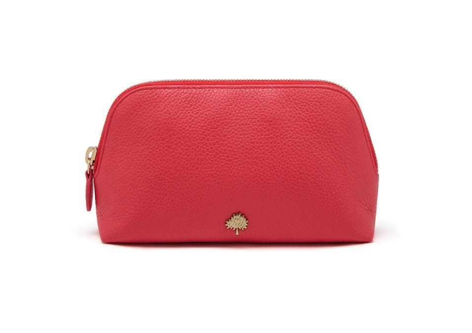 "<p>Mulberry Make Up Case Peony Pink Small Classic Grain, $310, <a rel=""nofollow"" href=""http://www.mulberry.com/us/shop/travel/travel-accessories/make-up-case-peony-pink-small-classic-grain"">mulberry.com</a></p>"