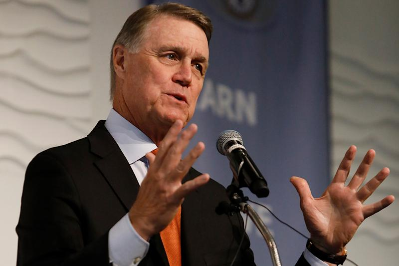 In this Aug. 6, 2019 photo, Sen. David Perdue, R-Ga., speaks during a Kiwanis Club of Atlanta luncheon. Former congressional candidate Jon Ossoff, D-Ga., will challenge Perdue in 2020, the Democrat tweeted Monday night, Sept. 9. (AP Photo/Andrea Smith, File)