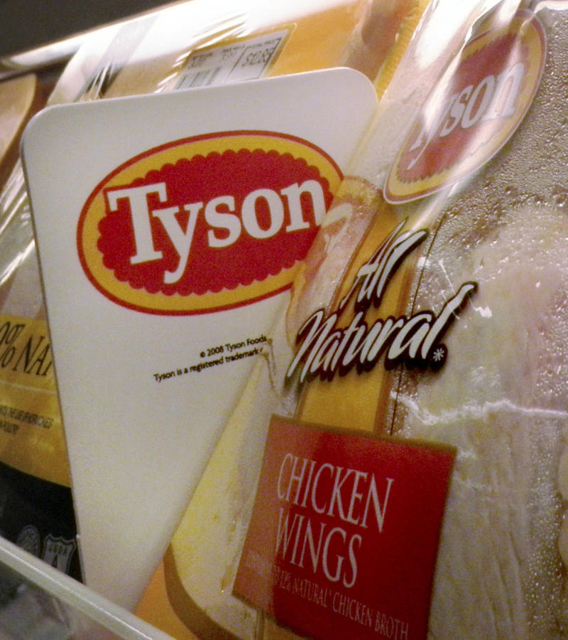 FILE - In this May 3, 2009 file photo, Tyson Foods chicken products are displayed on the shelves of a Little Rock, Ark. grocery store. Tyson Foods is reporting an 86 percent jump in earnings for the most recent quarter Friday, Feb. 4, 2011, helped by improving chicken sales and rising prices for beef and pork.(AP Photo/Danny Johnston, file)