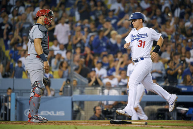 Los Angeles Dodgers' Joc Pederson, right, scores on a double by Justin Turner as St. Louis Cardinals catcher Andrew Knizner stands at the plate during the third inning of a baseball game Tuesday, Aug. 6, 2019, in Los Angeles. (AP Photo/Mark J. Terrill)