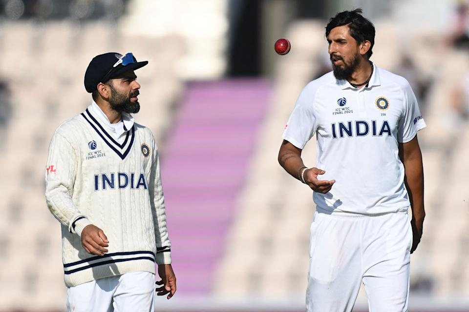 India's Virat Kohli (L) and India's Mohammed Shami chat on the final day of the ICC World Test Championship Final between New Zealand and India at the Ageas Bowl in Southampton, southwest England on June 23, 2021. - RESTRICTED TO EDITORIAL USE (Photo by Glyn KIRK / AFP) / RESTRICTED TO EDITORIAL USE (Photo by GLYN KIRK/AFP via Getty Images)
