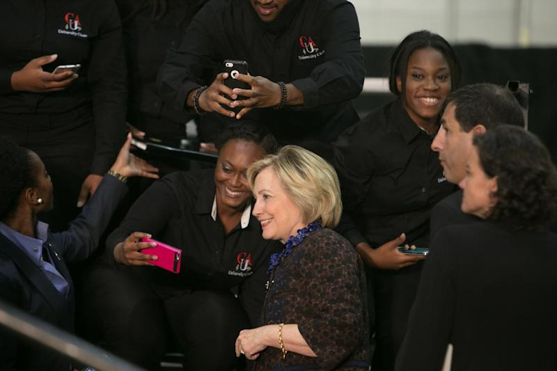 Democratic presidential candidate Hillary Clinton takes selfies with students at Clark Atlanta University in Atlanta, Georgia on October 30, 2015