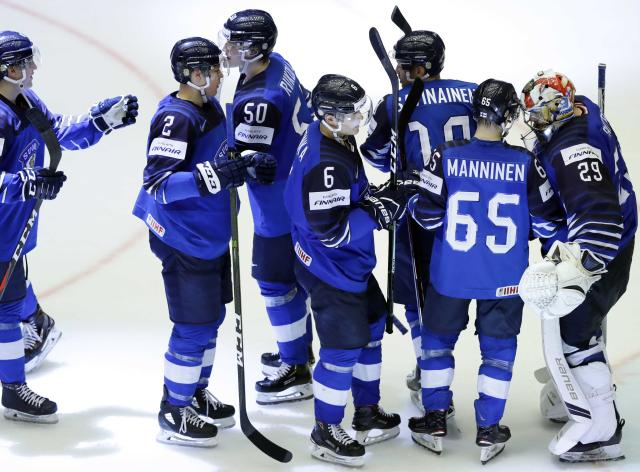Ice Hockey - 2018 IIHF World Championships - Group B - Finland v USA - Jyske Bank Boxen - Herning, Denmark - May 15, 2018 - Team Finland players celebrate victory. REUTERS/David W Cerny