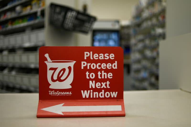A sign rests on a counter at a Walgreens pharmacy store in Austin, Texas