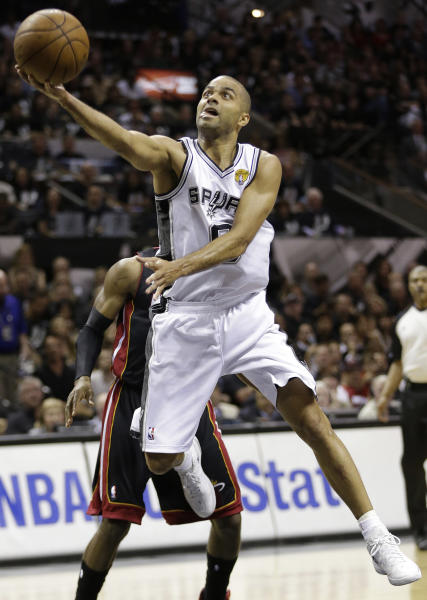 San Antonio Spurs' Tony Parker (9) shoots against the Miami Heat during the first half at Game 5 of the NBA Finals basketball series, Sunday, June 16, 2013, in San Antonio. (AP Photo/Eric Gay)