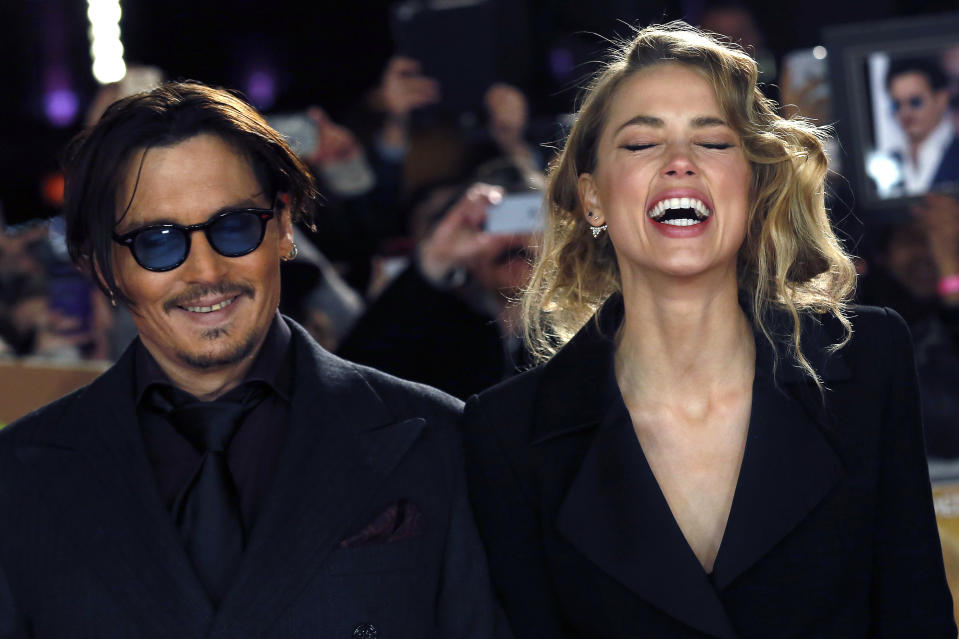 "Actor Johnny Depp and girlfriend Amber Heard laugh as they arrive for the UK premiere of ""Mortdecai"" at Leicester Sqaure in London January 19, 2015.  REUTERS/Luke MacGregor  (BRITAIN - Tags: ENTERTAINMENT)"