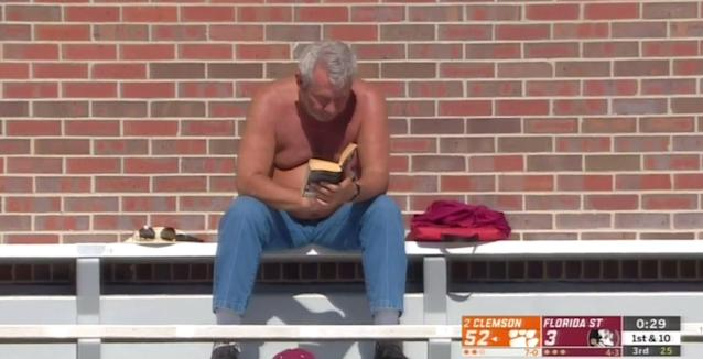 One Florida State fan turned to his book during the Seminoles' 49-point home loss to Clemson on Saturday. (ABC)