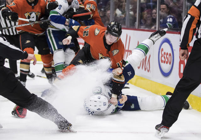 Anaheim Ducks' Josh Manson (42) punches Vancouver Canucks' Tyler Myers (57) during the second period of an NHL hockey game Sunday, Feb. 16, 2020, in Vancouver, British Columbia. (Darryl Dyck/The Canadian Press via AP)