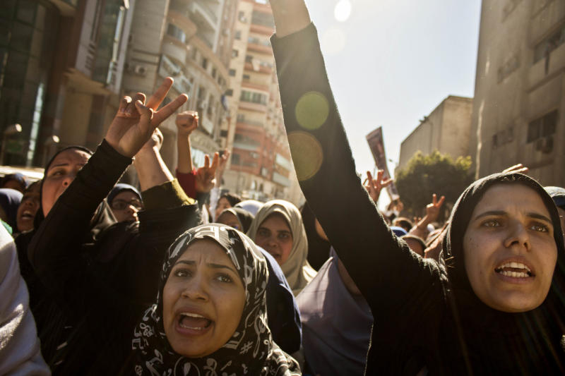 Egyptian women chant slogans during the funeral of victims killed from an explosion at a police headquarters, in the Nile Delta city of Mansoura, 110 kilometers (70 miles) north of Cairo, Egypt, Tuesday, Dec. 24, 2013. A powerful blast tore through a police headquarters in an Egyptian Nile Delta city early Tuesday, killing more than a dozen, wounding more than 100 and leaving victims buried under rubble in the deadliest bombing yet in a months-long wave of violence blamed on Islamic militants. No one immediately claimed responsibility for the bombing, which came a day after an al-Qaida-inspired group called on police and army personnel to desert or face death at the hands of its fighters. (AP Photo/Ahmed Ashraf)