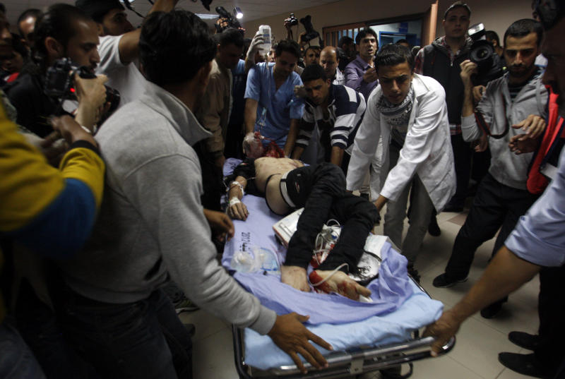 Palestinians bring a wounded man to a hospital in Gaza City, Saturday, Nov. 10,2012. An explosion targeted an Israeli military vehicle on the Jewish state's border with Gaza on Saturday and Israeli troops fired into the Palestinian territory, killing three civilians and wounding at least 25, among them children, Gaza officials and witnesses said. Ashraf al-Kidra, a Gaza health ministry spokesman, said four Palestinians killed were civilians between the ages of 16 and 18. (AP Photo/Hatem Moussa)