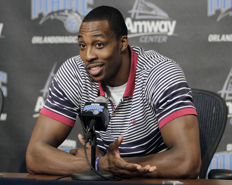 Orlando Magic center Dwight Howard answers questions during a news conference,Thursday, March 15, 2012, in Orlando, Fla. Howard signed a contract extension in 2007 hoping he would be town as long as the city's famous mouse.   (AP Photo/John Raoux)