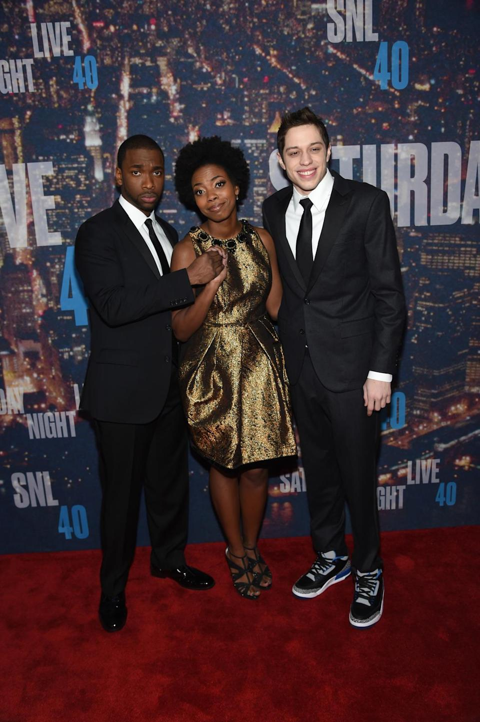 Current castmembers Jay Pharoah, Sasheer Zamata, and Pete Davidson make the step-and-repeat silly. While the boys look sharp in the suits, Zamata's gold dress is fitting for the celebratory atmosphere.