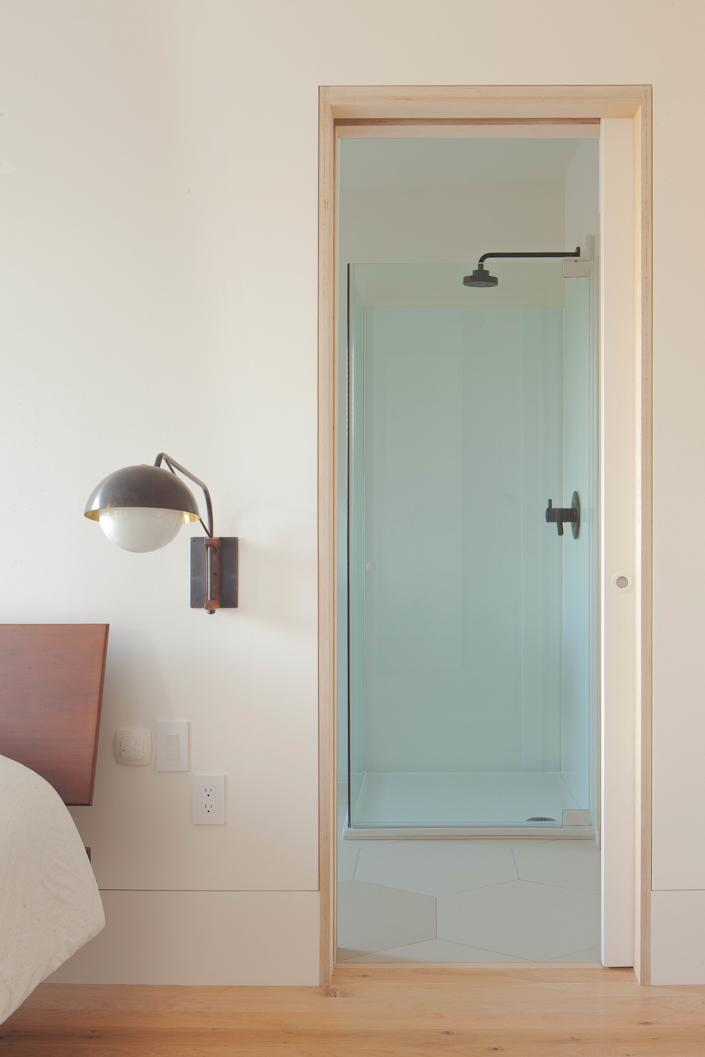 "<div class=""caption""> Plywood lines a doorway that leads from bed into bath. </div> <cite class=""credit"">Peter Dressel 2018</cite>"