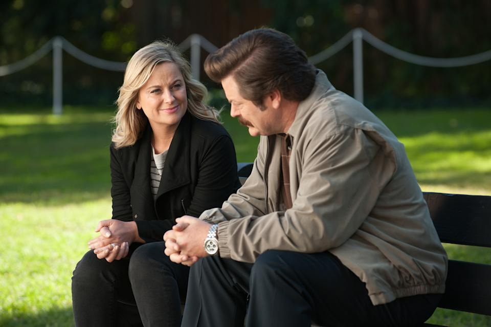 """PARKS AND RECREATION -- """"One Last Ride"""" Episode 712/713 -- Pictured: (l-r) Amy Poehler as Leslie Knope, Nick Offerman as Ron Swanson -- (Photo by: Colleen Hayes/NBCU Photo Bank/NBCUniversal via Getty Images via Getty Images)"""
