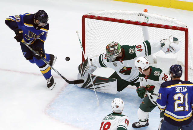 St. Louis Blues' Alexander Steen (20) is unable to score past Minnesota Wild goaltender Devan Dubnyk (40) during the first period of an NHL hockey game Sunday, Nov. 11, 2018, in St. Louis. (AP Photo/Jeff Roberson)