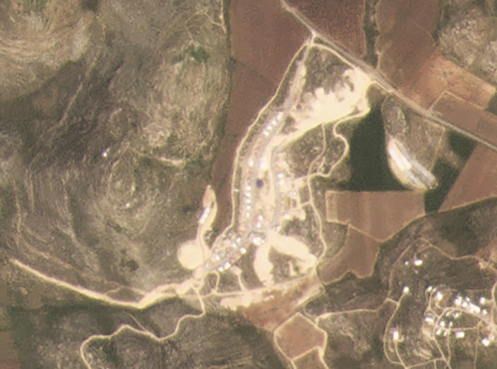 This satellite image provided by Planet Labs Inc. shows the West Bank Jewish settlement of Amichai on March 16, 2021. Satellite photos and data obtained by the AP document for the first time the full impact of the pro-settlement policies of then-President Donald Trump. (Planet Labs Inc. via AP)
