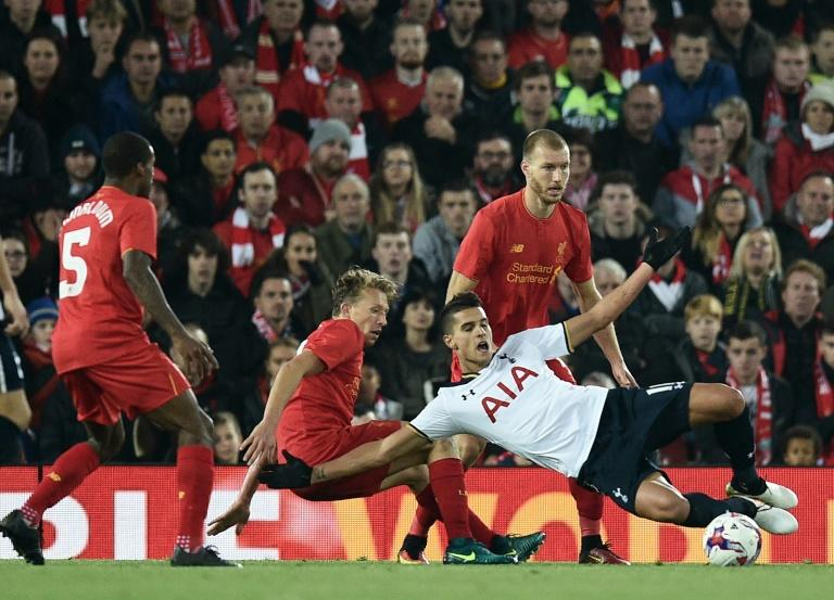 Tottenham Hotspur's Argentinian midfielder Erik Lamela (R) is fouled in the area by Liverpool's Brazilian midfielder Lucas Leiva resulting in a penalty for Spurs during the English Football League Cup fourth round match